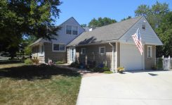Grey bungalow in West Bloomfield, Michigan prior to exterior remodel.