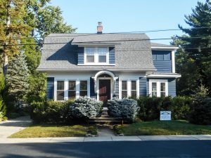 After photo of a home in Clarkston, Michigan, Grennan Construction completed a Roof replacement using CertainTeed Landmark shingles in the color pewter.