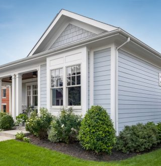 James Hardie Siding stock photo of light blue home.
