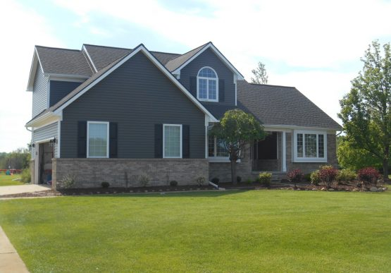 Exterior remodel with siding, roofing, and windows.