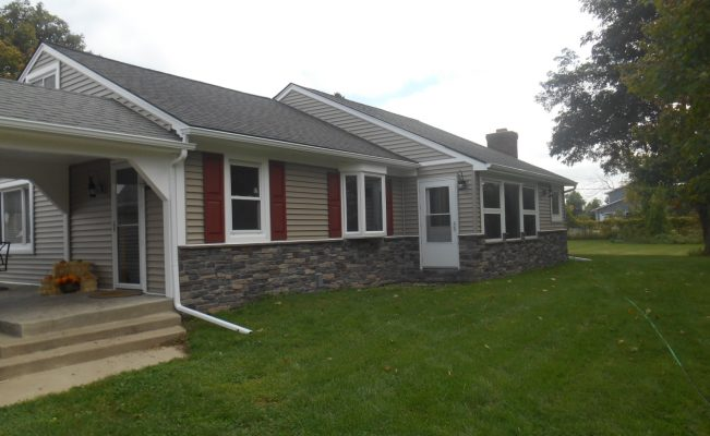 Exterior remodel with new siding, gutters, and stone. Ortonville, Michigan