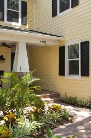 James Hardie Siding stock photo of yellow home.