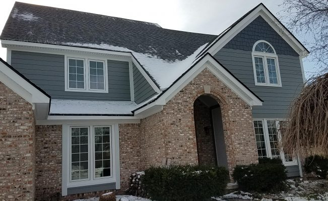 Exterior remodeling project including James Hardie siding. Canton, Michigan.